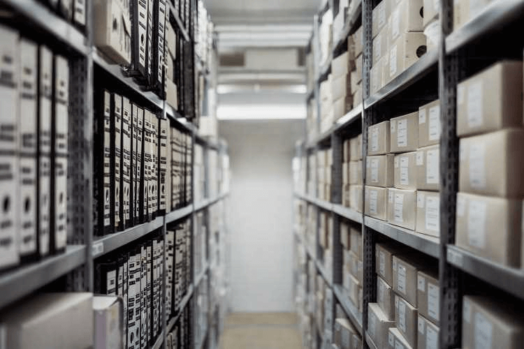 Warehouse shelving which presents a documents in files & boxes.
